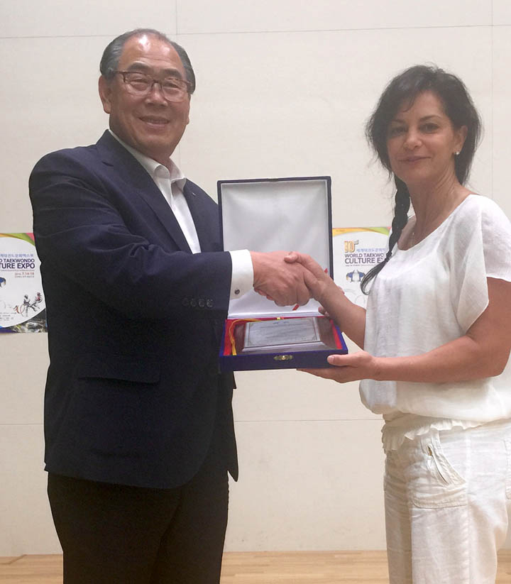 Master Amitis Pourarian receives a plaque for her contribution to globalization of Taekwondo from the Taekwondowon in Muju, Korea. July 2016